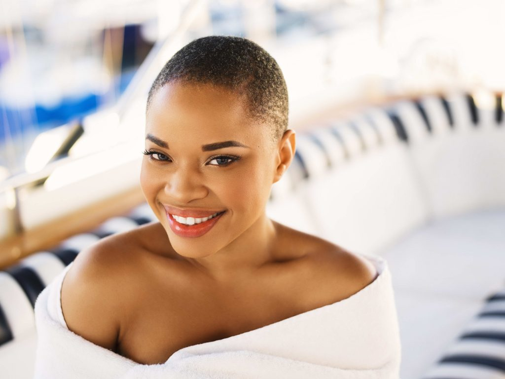 Beauty portrait of black woman on yacht
